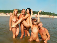 Lots of nudist people of vagious ages in sea