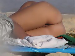 Nudist women's butts filmed on nude beach